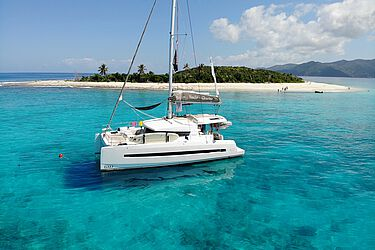 Catamaran in front of Sandy Cay
